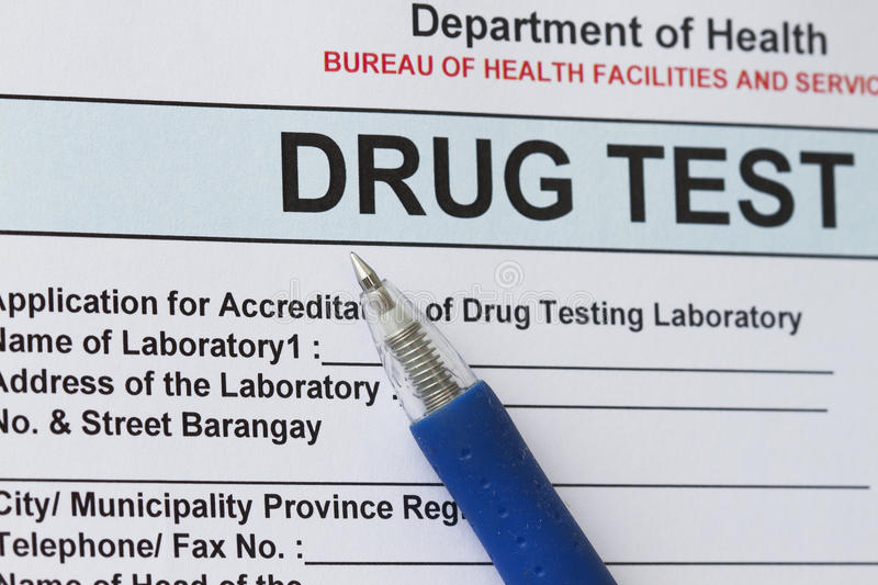 Drug test. Blank form with blue pen royalty free stock photo
