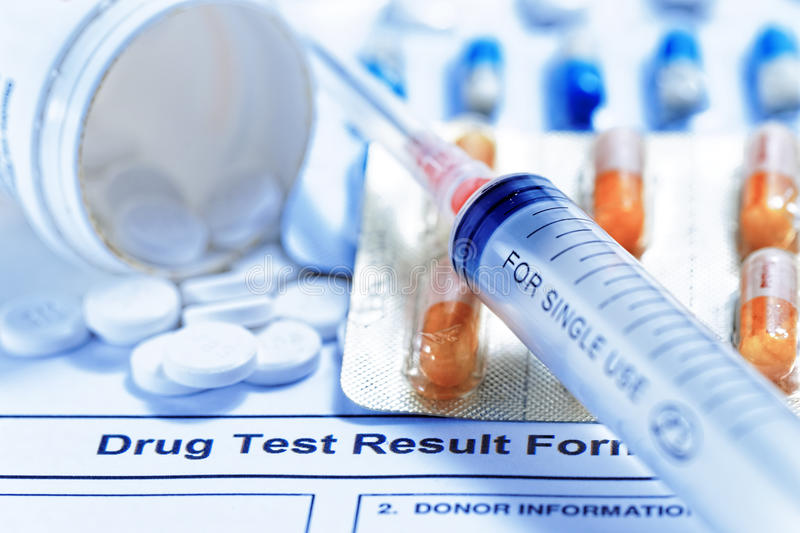 Drug test report. Syringe with glass vials and medications pills drug test report stock photos