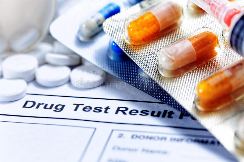 Drug test report. Syringe with glass vials and medications pills drug test report royalty free stock image