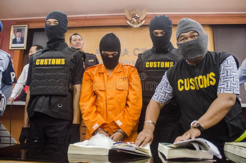 DRUG TRAFICKER. A captured meth smuggler was publicized to the press by Indonesian Customs at Solo, Java, Indonesia. Illegal drug trader and trafickers face royalty free stock images