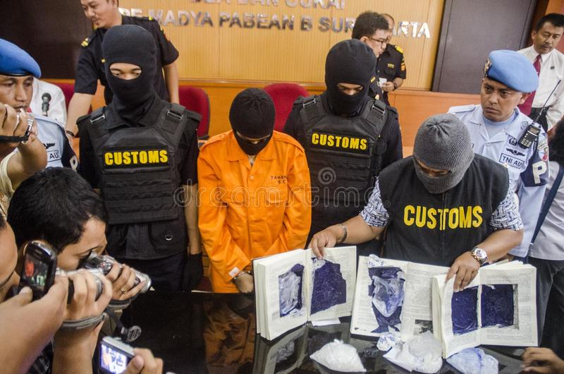 DRUG TRAFICKER. A captured meth smuggler was publicized to the press by Indonesian Customs at Solo, Java, Indonesia. Illegal drug trader and trafickers face stock image