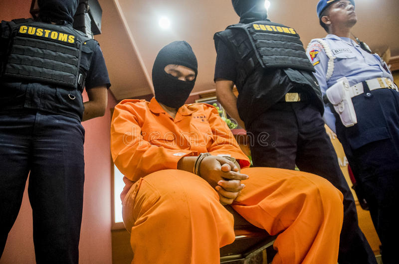 DRUG TRAFICKER. A captured meth smuggler was publicized to the press by Indonesian Customs at Solo, Java, Indonesia. Illegal drug trader and trafickers face royalty free stock photos