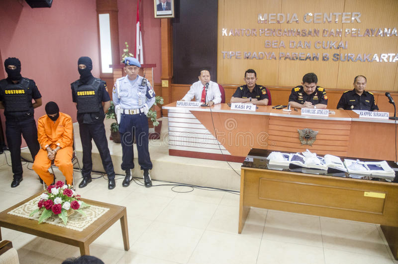 DRUG TRAFICKER. A captured meth smuggler was publicized to the press by Indonesian Customs at Solo, Java, Indonesia. Illegal drug trader and trafickers face royalty free stock image