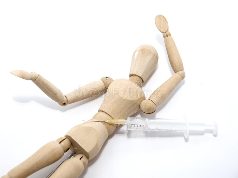 Drug Use. Wooden man with a syringe royalty free stock photography