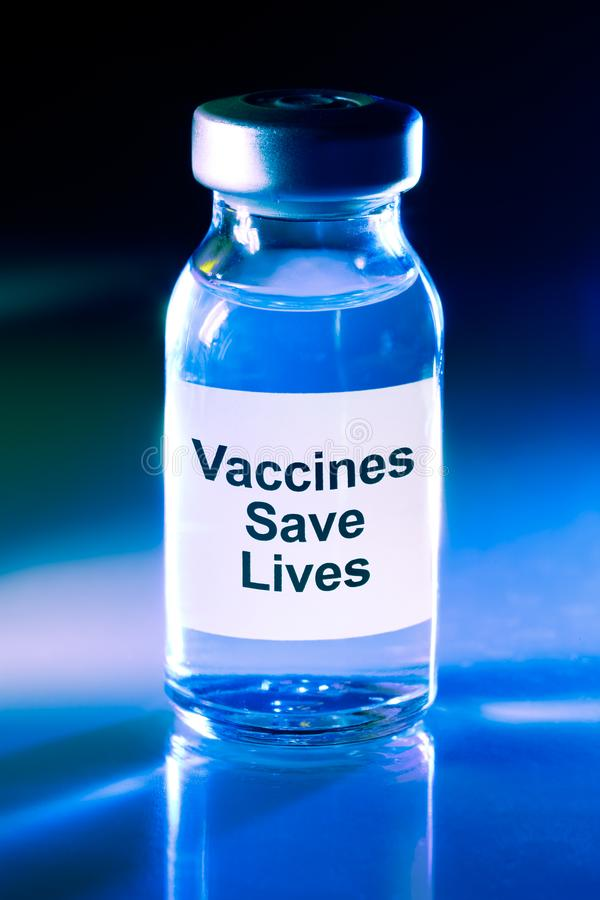 Drug vial - Vaccines Save Lives. Drug vial with label - Vaccines Save Lives royalty free stock photos