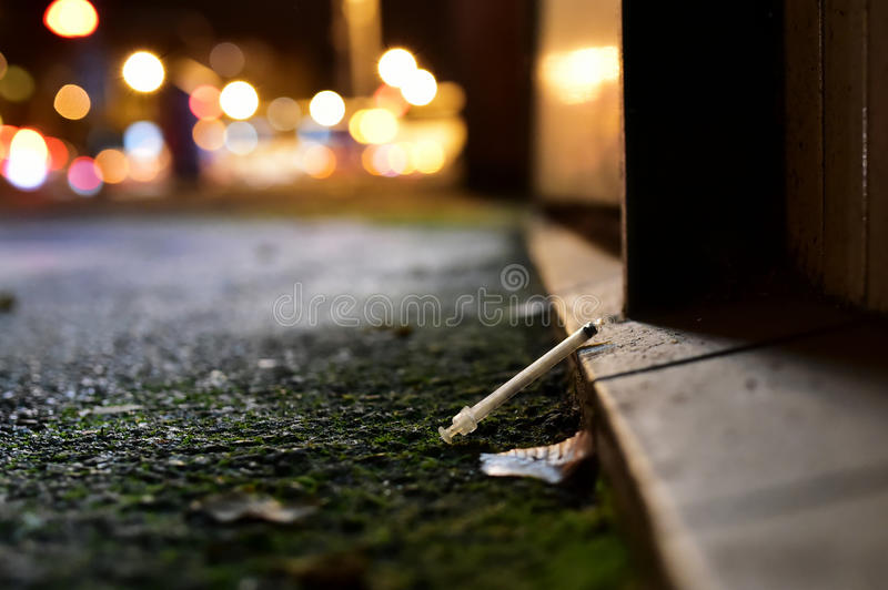Drugs in the city - street photography. Unarranged photo. Downtown Prague. The syringe on the street stock photography