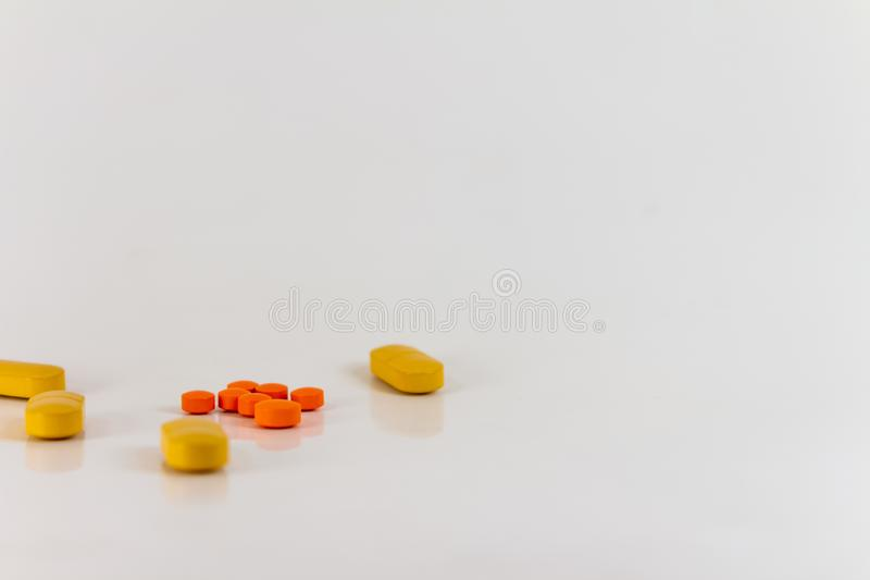 Drugs in the form of pills of different sizes, shapes and colors. stock photography