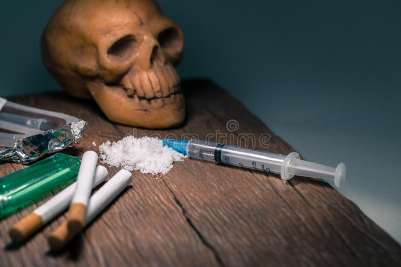 Drugs and skull on the old wooden floor royalty free stock photo