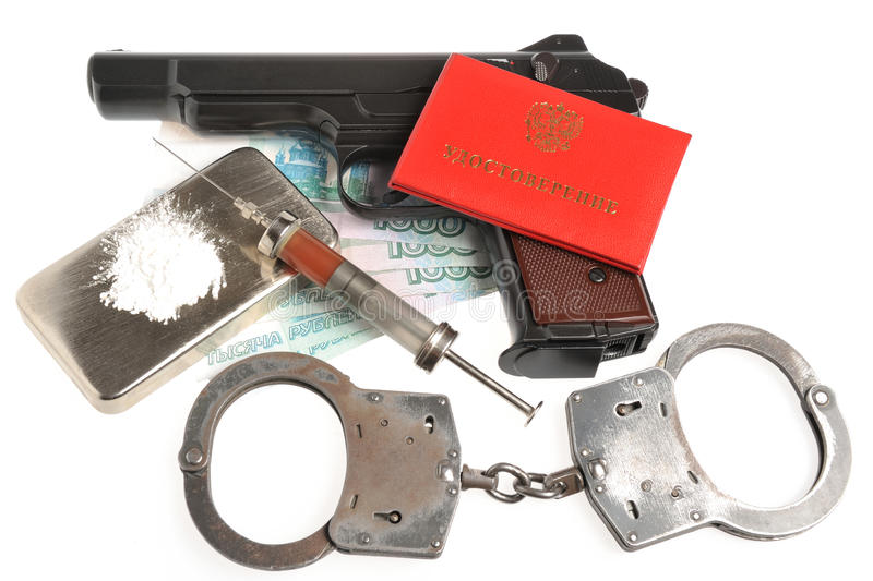 Drugs, syrine with blood, pistol, handcuffs, identity document stock images