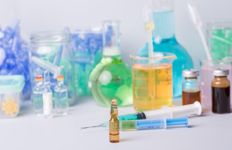 Drugs. Syringe with ampules of drugs royalty free stock image