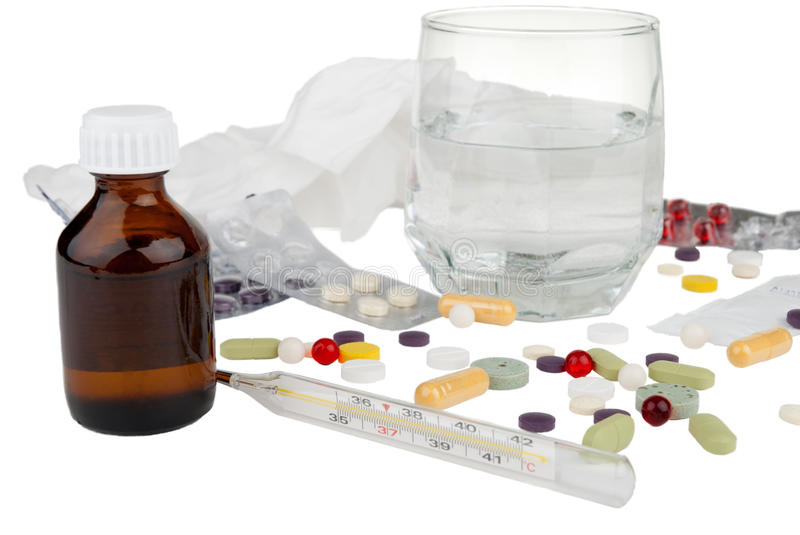 Drugs, thermometer and glass with aspirin stock photo
