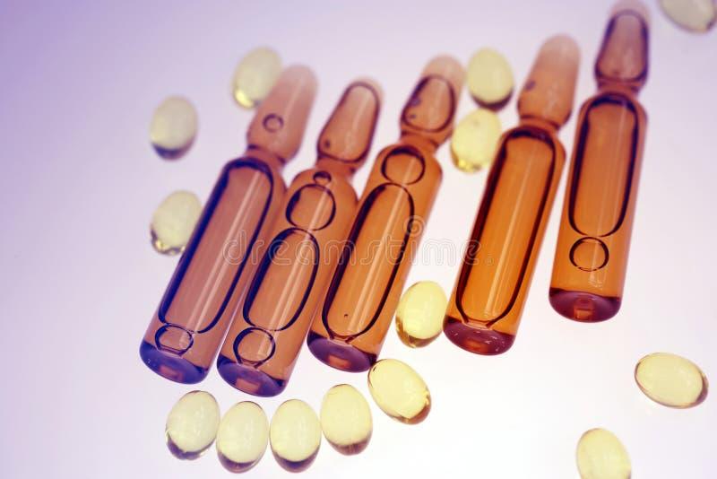 Drugs or vitamins in vial stock image
