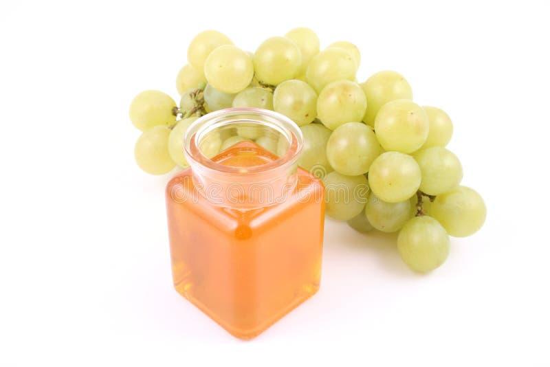 Druiven en honing stock fotografie