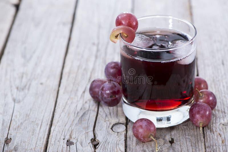 Druivesap met Ijs royalty-vrije stock afbeeldingen
