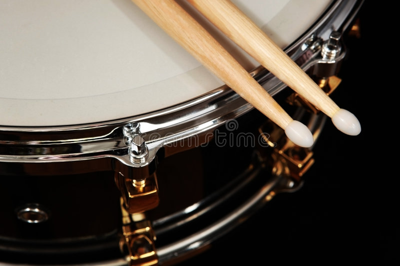 Drum. Close up drum with drumsticks on black background stock photo