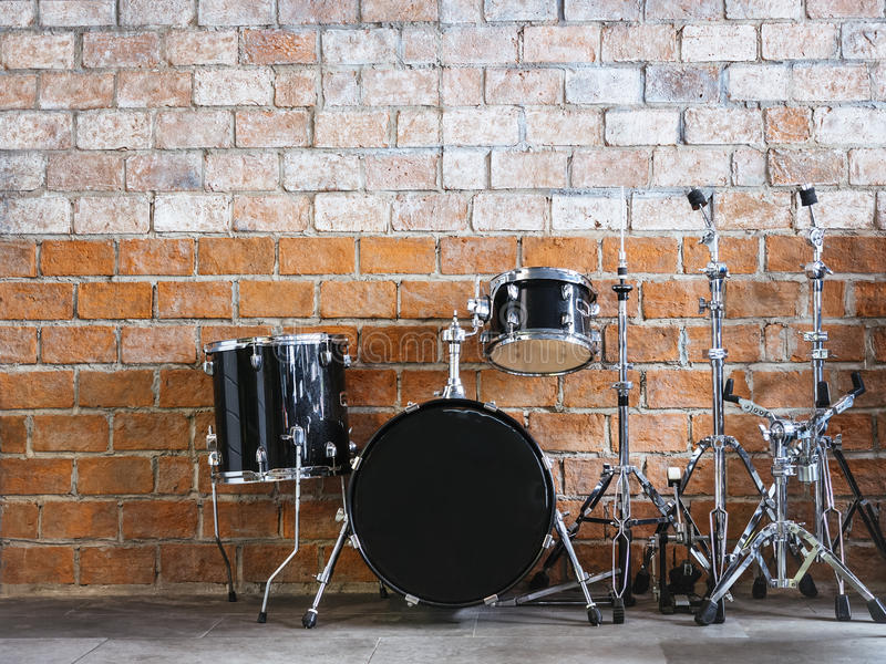 Drum Music instrument Sound equipment on Brick wall stock photos