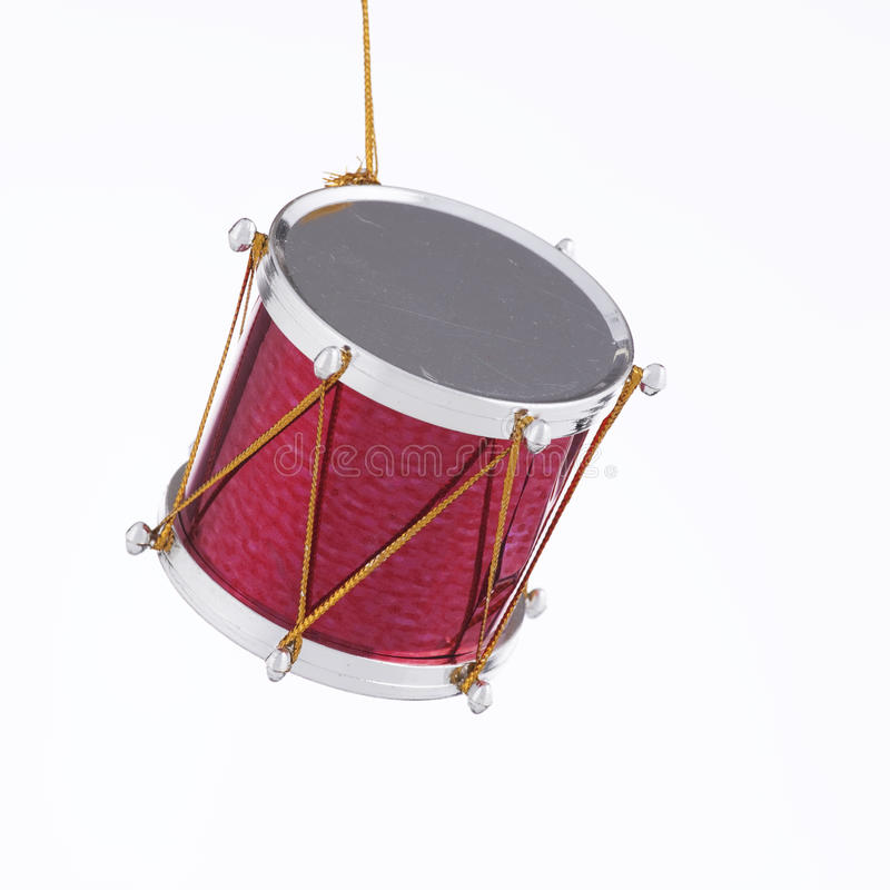 Drum Ornament for Christmas Tree. A marching drum toy ornament for Christmas tree isolated on a white background in the square format royalty free stock image