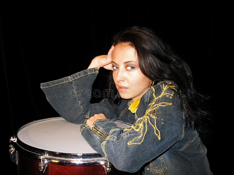 Drum school. drum kit. musical instruments. lets play rock music. jeans jacket. sexy woman drummer isolated on black. learn drummi. Drum school. drum kit stock photo