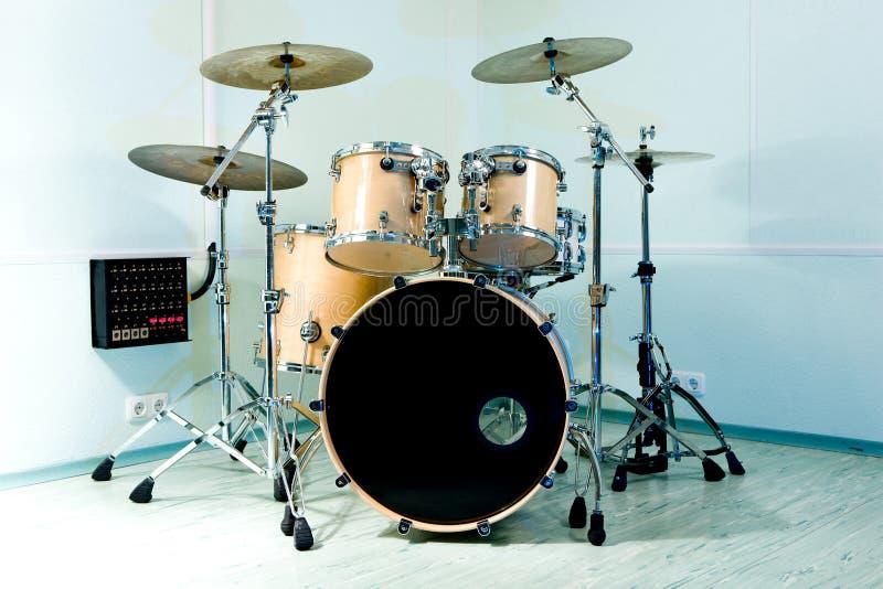 Drum set. In blue studio stock images