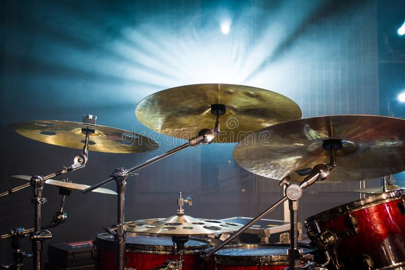 Drum set on stage and light background; empty stage with instruments ready for performance royalty free stock photos