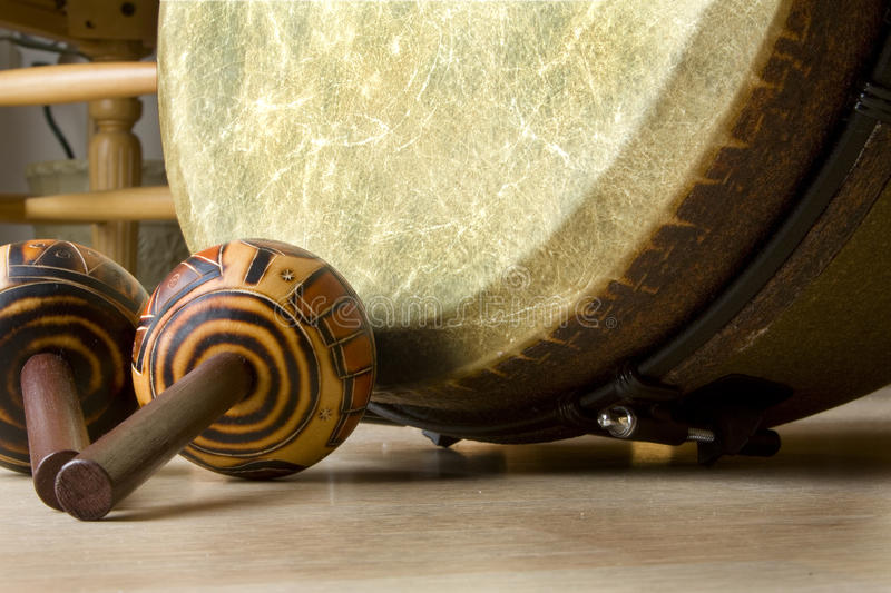 Drum with shakers. Image of shakers and drum laying on side stock photo