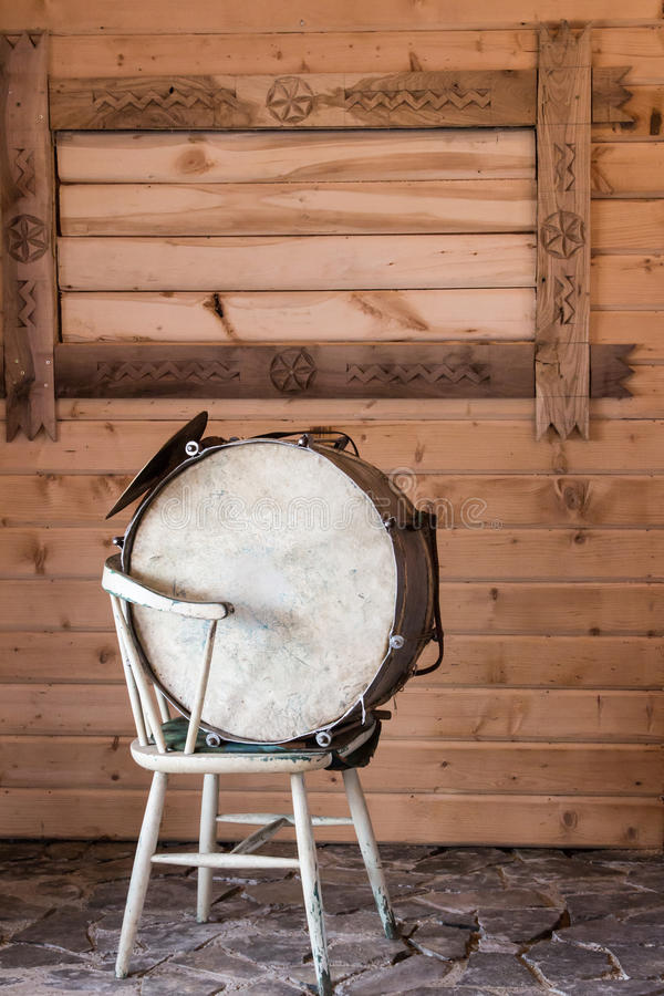 Drum. A traditional drum with dog skin on it, sitting on a chair. Maramures, Romania royalty free stock photo