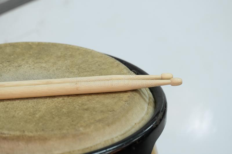 Drum and wooden stick. In a room close up royalty free stock images