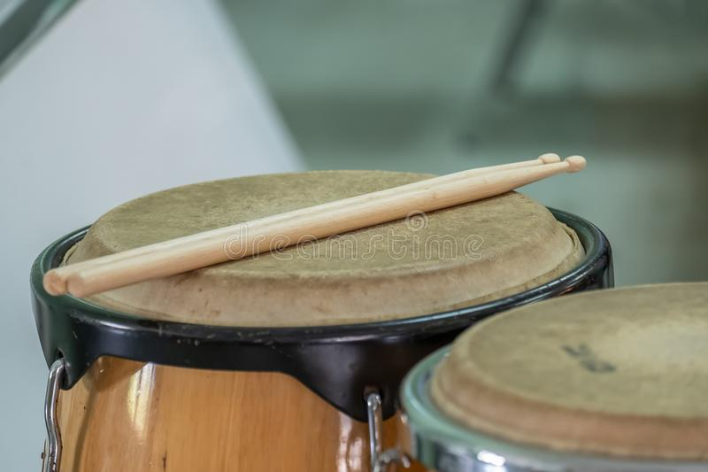 Drum and wooden stick. In a room close up royalty free stock photo