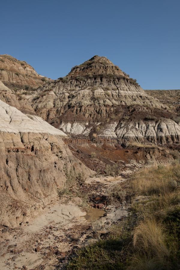 Drumheller Badlands Alberta Scenery Travel. The Drumheller Badlands in Alberta. Deep in the backcountry hiking trails are the best views as seen here stock image