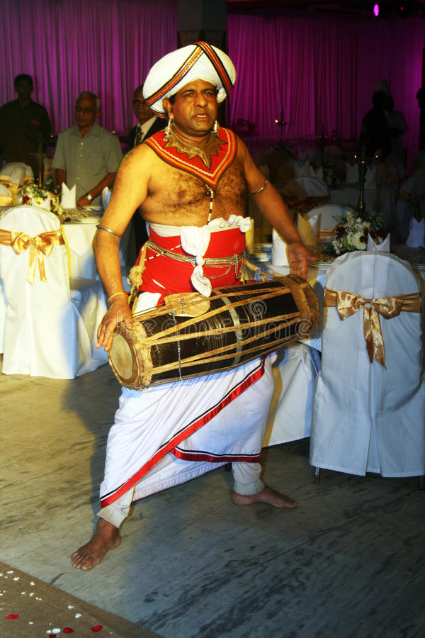 Drummer. A srilankan drummer with traditional clothes during a wedding in kandy in sri lanka.august 2011 royalty free stock photo