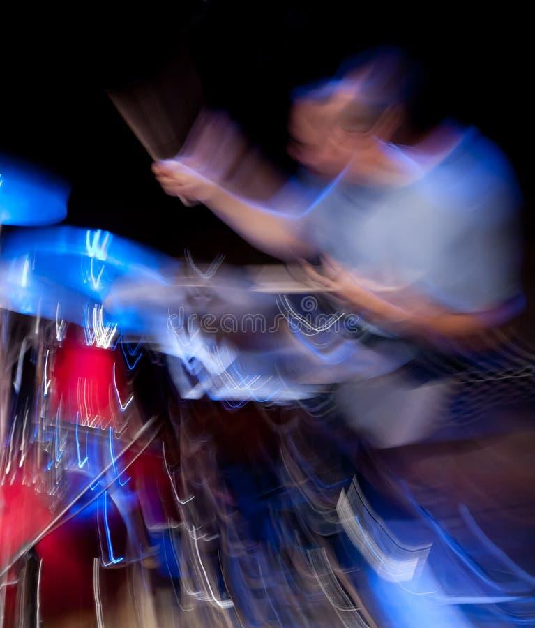 Drummer in action, motion blur