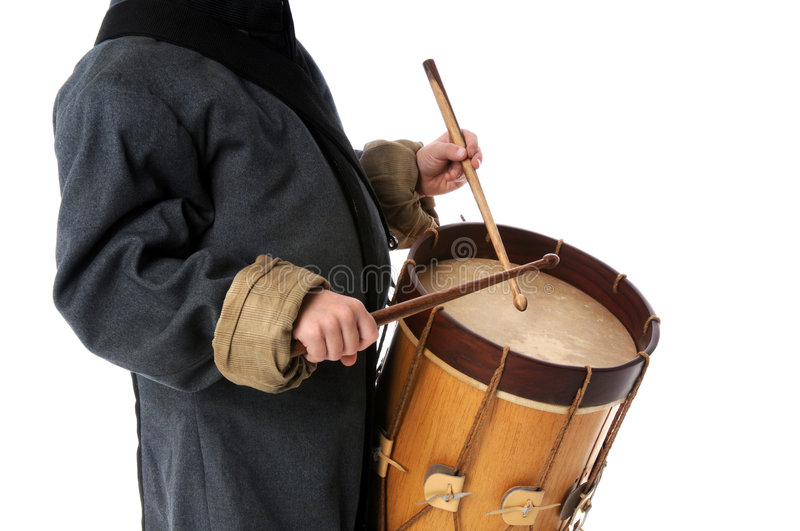 Drummer Boy. Playing over a white background royalty free stock images