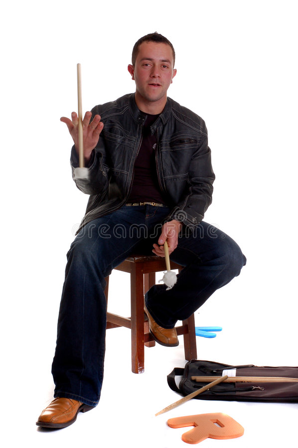 Drummer Boy. A drummer boy sitting on a stool, with drum sticks in his hand stock photos