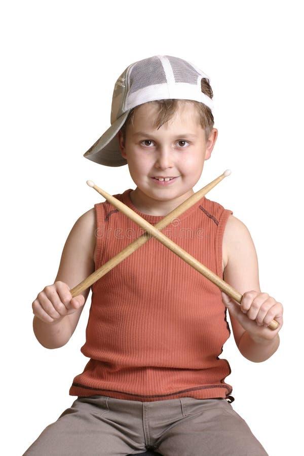 Drummer with crossed drumsticks. Little boy with crossed drumsticks stock images