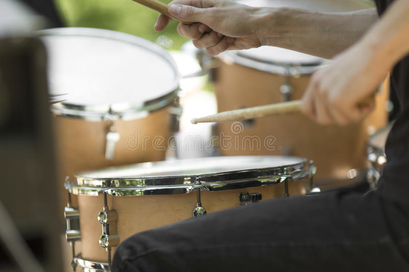 Drummer hands. Detail of a drummer on the rock concert royalty free stock photo