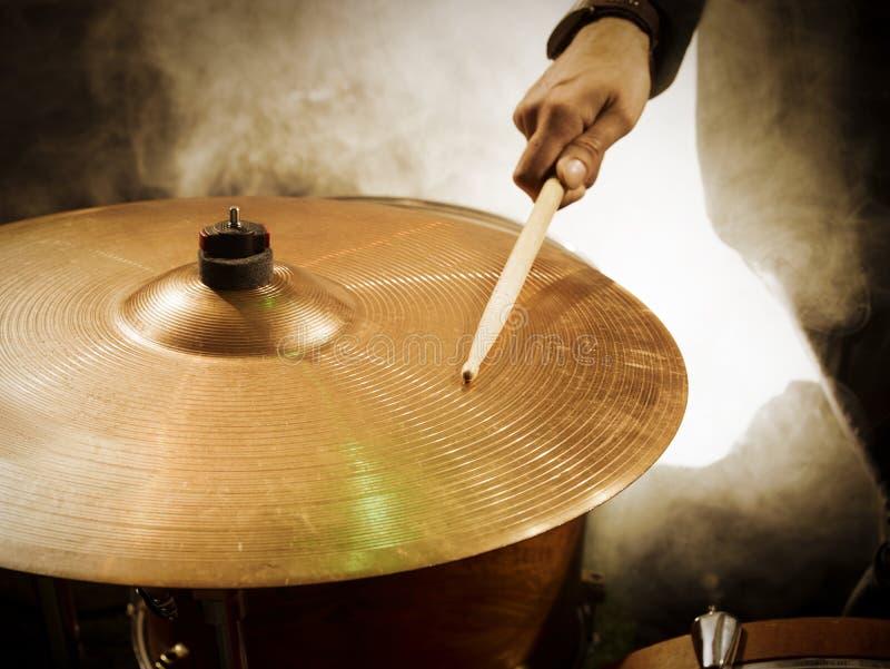 Drummer hitting sticks in ride. stock photo