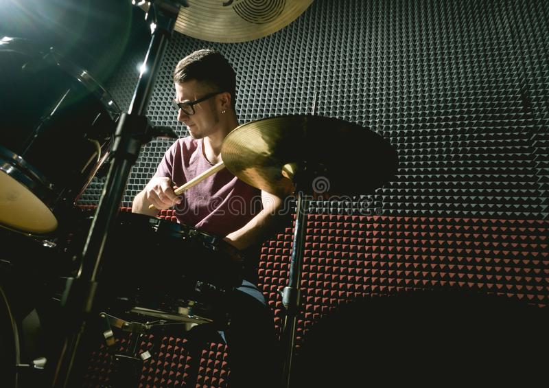 Drummer in music studio playing drums stock photography
