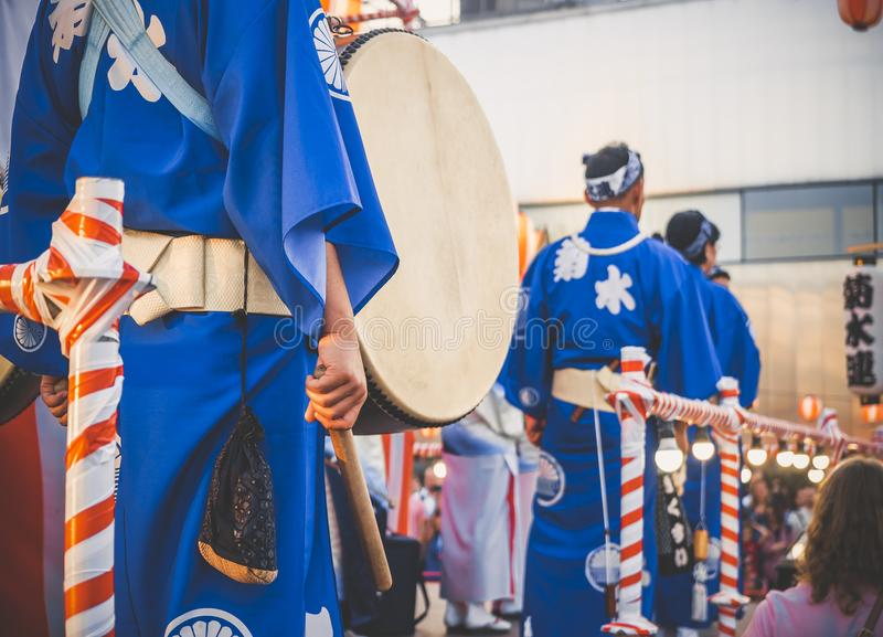 Drummer performance, Taiko Drums Japanese folklore. Japanese artists perform at Bon Festival in blue kimonos with big drums.  stock images