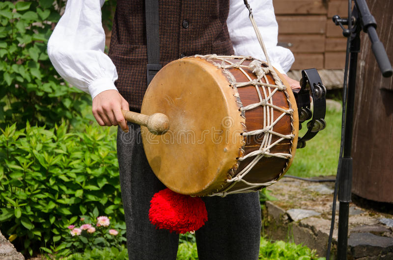 Drummer play folk music with drum and stick royalty free stock image