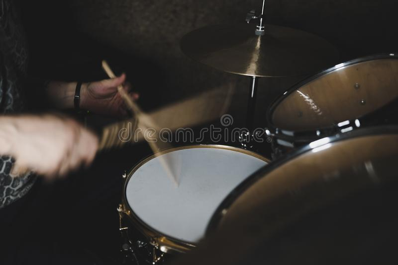 Drummer playing a drum kit. Professional drummer playing a drum kit in a studio setting stock photo