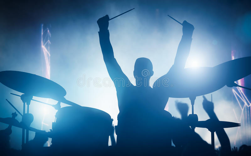 Drummer playing on drums on music concert. Club lights. Artist show royalty free stock photos
