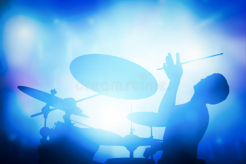 Drummer playing on drums on music concert. Club lights. Artist show royalty free stock photography