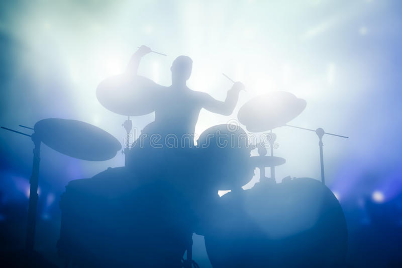 Drummer playing on drums on music concert. Club lights. Artist show stock image