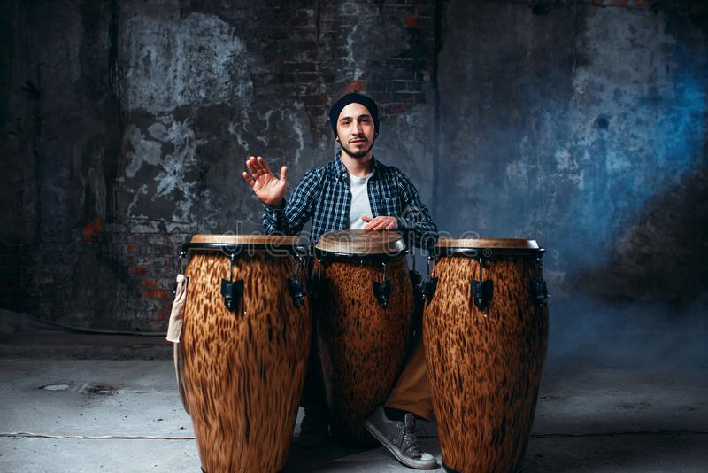 Drummer Playing On Wooden Bongo Drums, Beat Rhythm Stock Photo - Image of  leather, percussion: 106139002