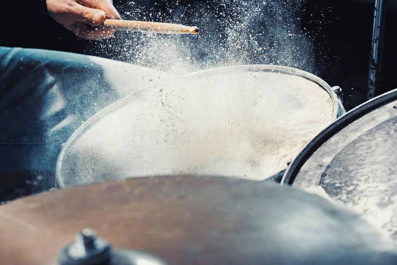Drummer rehearsing on drums before rock concert. Man recording music on drum set in studio. The hands of drummer rehearsing on drums before rock concert. Man stock images