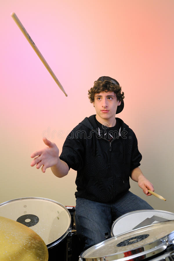 Drummer with stick in air royalty free stock images