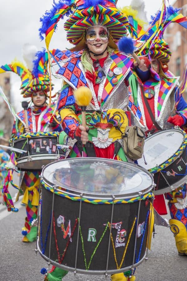 Drummer woman playing at Carnival parade of Badajoz, Spain. Badajoz, Spain - February 28, 2017: Drummer woman playing at Carnival parade of Badajoz. This is one royalty free stock image