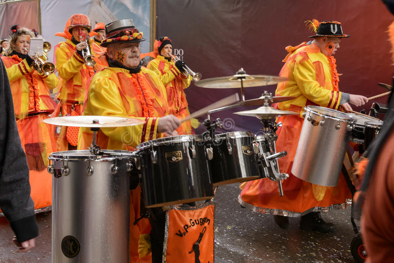 Drummers group of marching band at Carnival parade, Stuttgart. STUTTGART, GERMANY - FEBRUARY 09: a group of drummers in dressed up marching band in parade in wet stock image