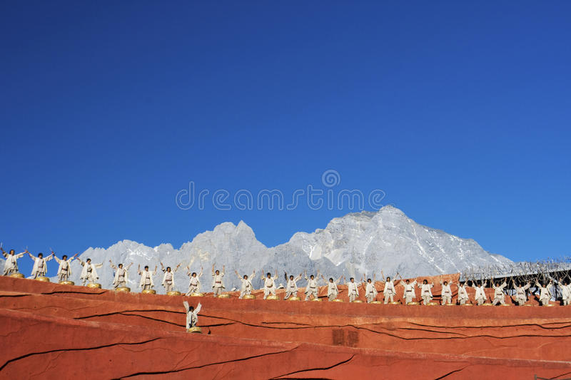 Drummers performing at Impression Lijiang. Against background of Jade Dragon Snow Mountain, Lijiang, Yunnan, China stock photography