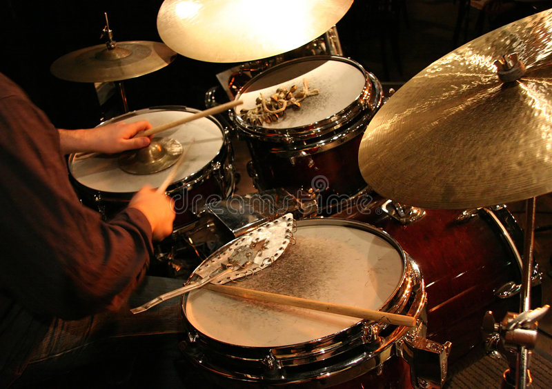 Drums. A drummer at a concert with various drums and percussion